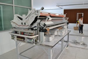 เครื่องปูผ้าเข้าสู่พื้นที่การผลิต